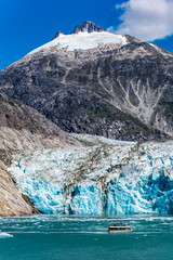 Wide angle view of Dawes Glacier with tourist boat