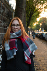 Portrait of beautiful young red hair girl in autumn Amsterdam, outdoor