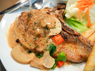 Kurobuta pork chop with black pepper sauce easy. Close up
