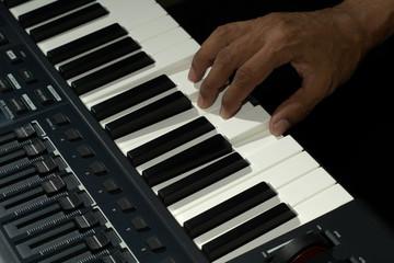 Hand on keys