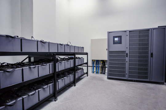Room with many cables and many batteries. Backup power for larger buildings.