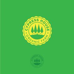 Organic farm emblem. Cypress house logo. Cypress trees and a farm in a yellow badge