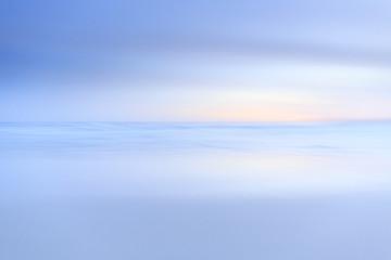 Blur of the ocean.