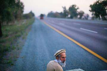 A man praying roadside