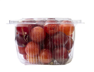 Fresh plums in transparent plastic package. Isolated on a white background
