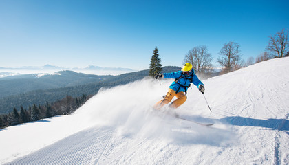 Shot of a professional skier riding the slope in a beautiful winter day copyspace ski resort recreation travelling tourism vacation extreme adrenaline