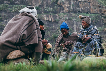 A group of Basotho herdsmen sitting and talking in the mountains