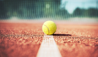 Tennis ball on the tennis court. Sport, recreation concept