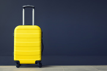 Yellow suitcase.