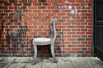 A chair left by a wall