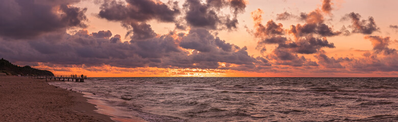 Panorama of a beach sunset over Baltic sea