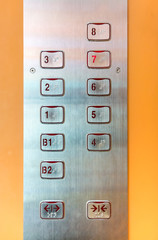 Elevator buttons panel with brushed metal texture surface plate