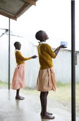 School children collecting rain water. Kenya.