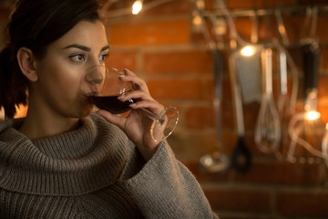 Close up of thoughtful woman having wine