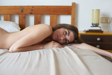 Attractive young woman on bed