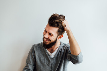 Handsome Bearded Man Playing With His Hair