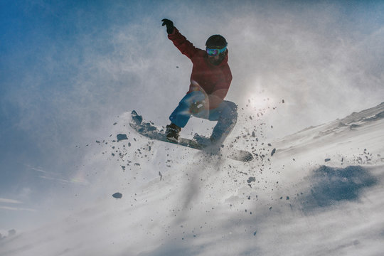 snowboarder jumping down the hill