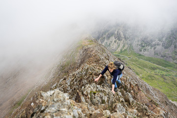 Female climber in rugged mountains.