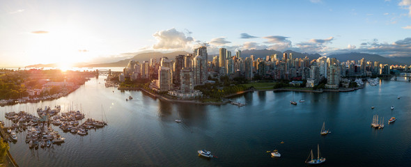 Aerial Panorama of Downtown City at False Creek, Vancouver, British Columbia, Canada. Taken during a bright sunset.
