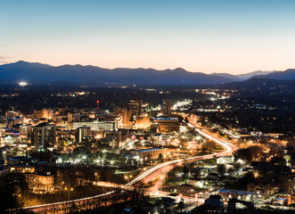 Asheville city at night with traffic motion