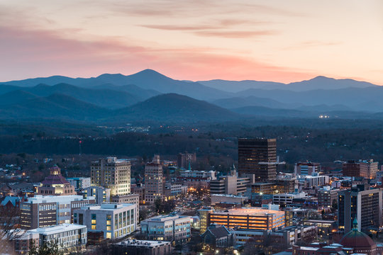 View of Asheville city skyline and mountains after sunset