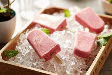 Strawberry popsicle on ice basket
