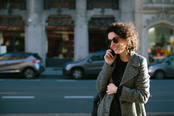 Woman on the phone in the street