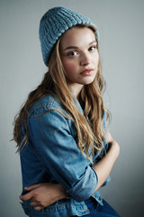 Studio portrait of a young woman in denim