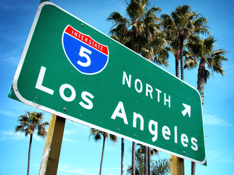 Los Angeles freeway sign with palm trees