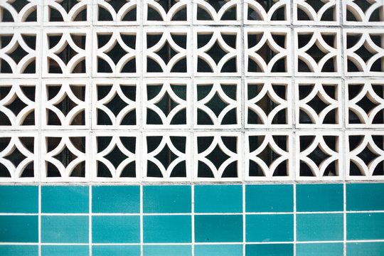 Breezeblocks wall and blue tiles