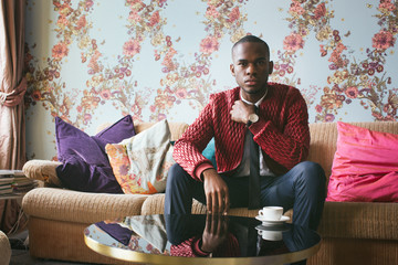 Indoor Portrait of Stylish Young Black Man in Bright Living Room