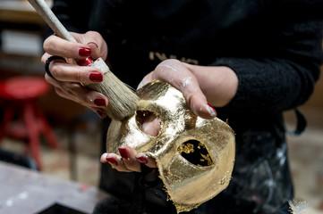 Woman making venetian mask on a workshop
