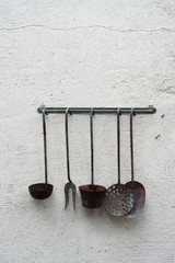 old kitchen utensils on a wall as art