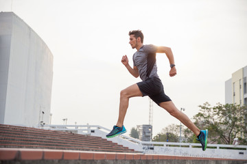 Fit male fitness runner during outdoor workout