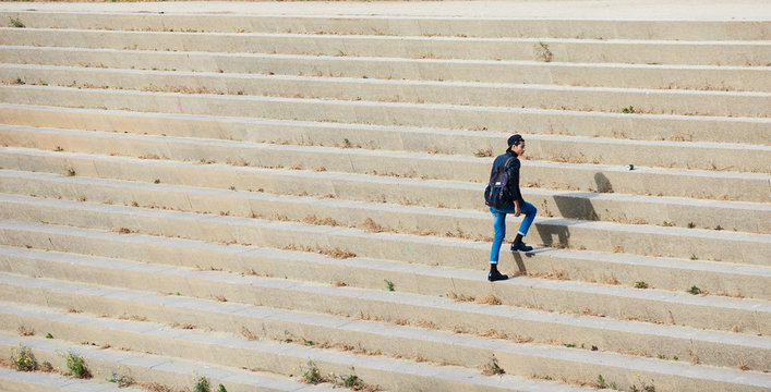 Man with backpack climbing the stairs