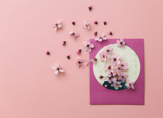 A picture print on pink background with pink flowers