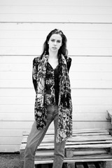 Black and white photo of a girl in interesting pattern clothes