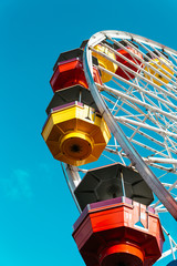 Bright ferris wheel against of blue sky
