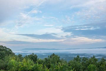 A summer morning look at the foggy hills and valleys near Heflin, Alabama, USA