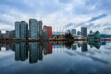 Beautiful cloudy morning sunrise with the view of False Creek in Downtown Vancouver, British Columbia, Canada.