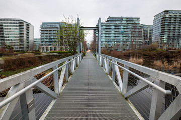 New apartment buildings around a beautiful park in False Creek, Vancouver, British Columbia, Canada. Taken during a cloudy sunrise in spring time.
