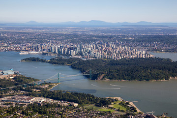 Aerial Cityscape View of Downtown, Stanley Park and Lions Gate Bridge in Vancouver, British Columbia, Canada. Taken during a sunny summer day. Wall mural