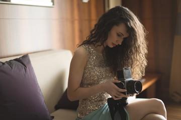 Woman checking photos in digital camera