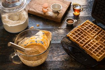 Making pumpkin waffles for breakfast