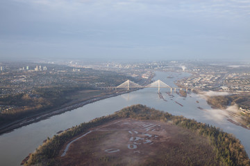 Aerial view on Douglas Island, Fraser River and Port Mann Bridge. Taken early morning.