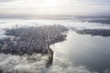 Aerial view of Downtown Vancouver, British Columbia, Canada, covered in clouds. Taken during a foggy winter sunrise. Wall mural