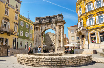 Ancient Roman triumphal arch or Golden Gate and square in Pula, Croatia, Europe