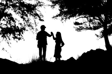 Silhouettes of a women and a man