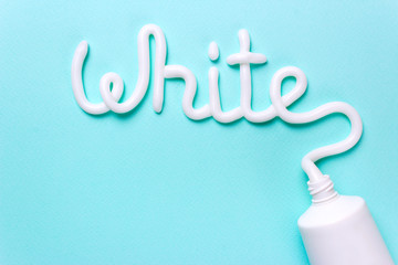 The word white is from the toothpaste. Tube for cleaning teeth and whitening. Copy space for text