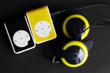 Yellow music player and beautiful overhead headphones